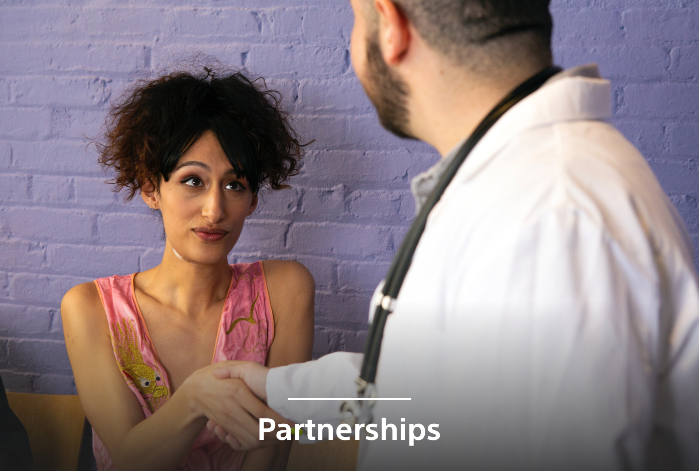 female patient with male doctor shaking hands